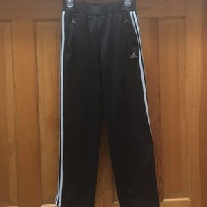 Adidas pants. Black with 3 white stripes down legs